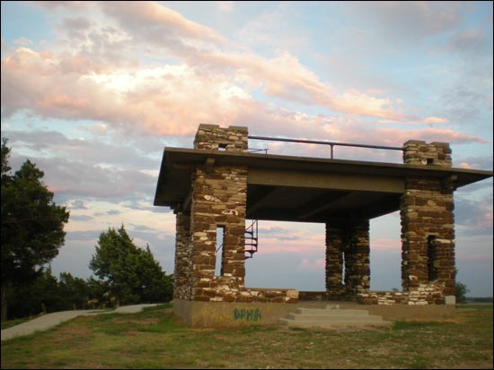 The setting sun brightens the pavilion atop Pawnee Rock State Park. Photo copyright 2014 by Leon Unruh.