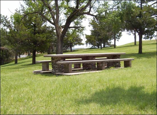 The sandstone-and-concrete picnic table and benches has stood on the northern flank of Pawnee Rock State Park for decades. Spencer Hines of Arizona, a great-great-grandson of Lucy Houdyshell, made this photo early in July. Photo copyright 2008 by Spencer Hines.